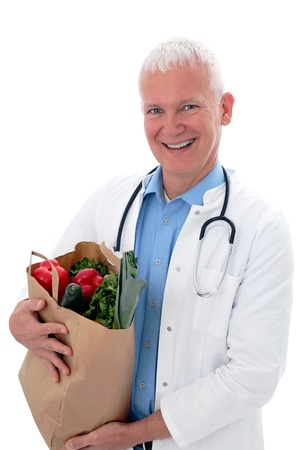 Doctor with vegetables in a shoppin bag Stock Photo - 12980689
