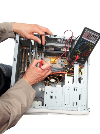 Professional repairing a PC isolated Stock Photo - 13106297