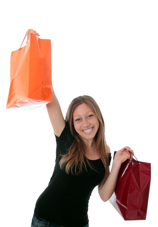 Jung woman with 2 colerful shopping bags in the air Stock Photo - 13554214
