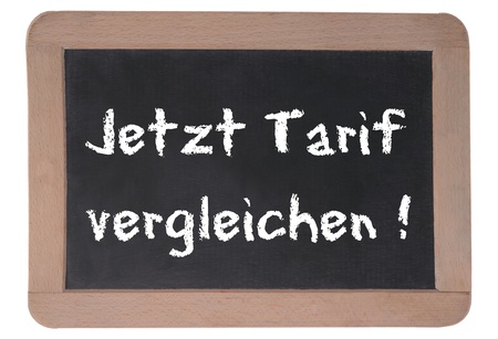 Compare Tarifs now written on a board in german