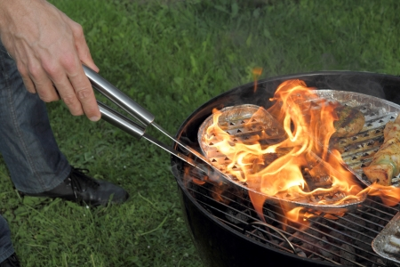 Meat burning on top of a BBQ Grill Stock Photo