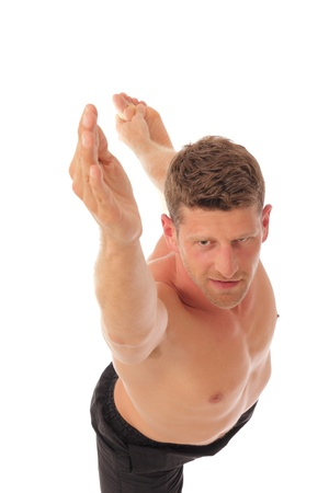 shirtless athletic male holding a pose with arms outstretched upward photo
