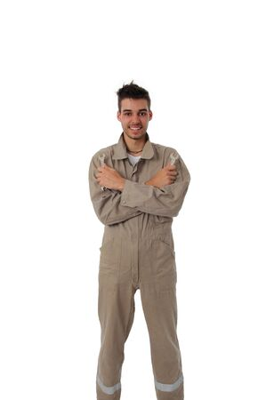 Young male artisan or workman standing in fresh clean overalls with his tools on a white studio background Stock Photo - 13925994