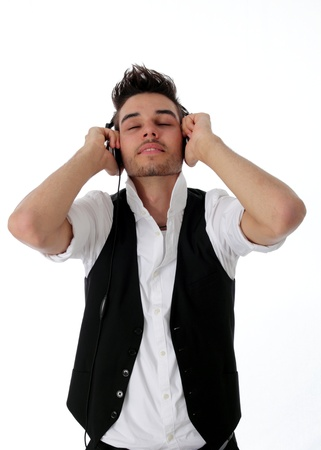 enraptured: Young man wearing earphones smiling contentedly with his eyes closed as he is enraptured by his music Stock Photo