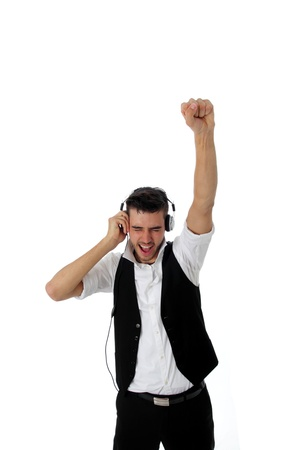 listen fist: Exuberant young man listening to music punching the air with his fist as he becomes totally absorbed in the soundtrack