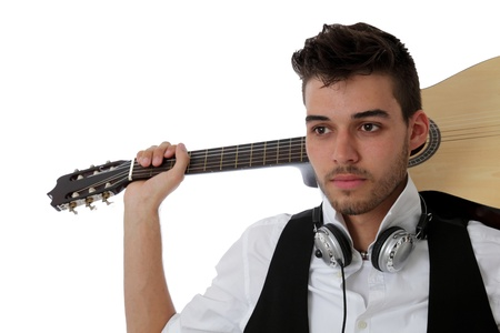 Young musician with acoustic guitar and headphones around his neck isolated on white photo