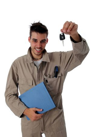 Friendly mechanic clutching the job card and holding up car keys to show he has completed the repair or service Stock Photo - 13926013