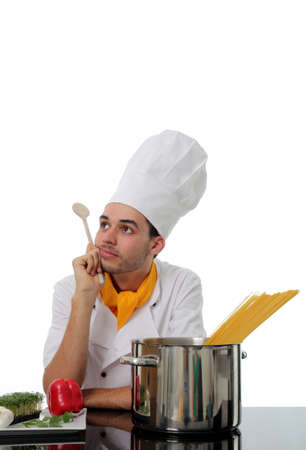 Chef daydreaming while making spaghetti with fresh ingredients and the pasta ready to boil photo