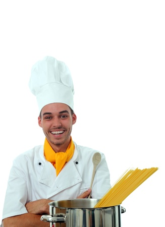 stainles steel: Smiling Cook in front of a pot with crossed armes
