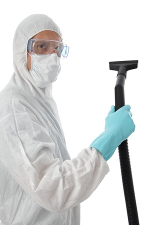 Professional cleaner in protective suit with safety goggles and mask about to commense work with his vacuum to clean the interior of a building, isolated