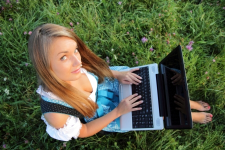 Bavarina Woman in Flowering Meadow with Laptop from above