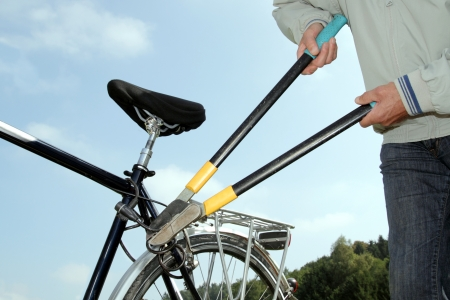 Theft cutting a bicycle lock with a tool Stock Photo - 15471855