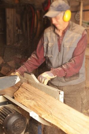 Man cutting firewood with circular saw Stock Photo - 15470233