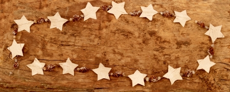Frame with Christmas dicoration on a wooden board Stock Photo - 16540861