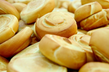 deficiencies: Many fresh baked rolls in a industrial bakery