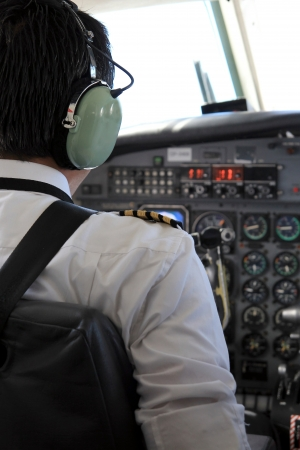 Pilot in a cockpit flying a plane  photo
