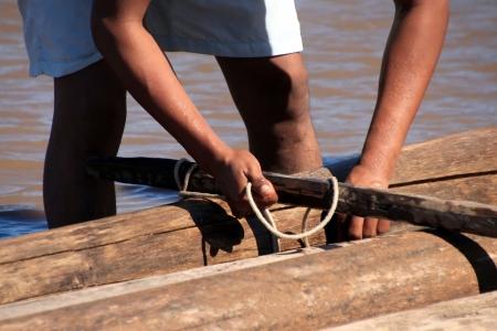 balsa: A Man building a raft