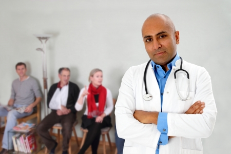 Waiting room with patients and a doctor Stock Photo