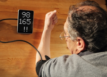 Elder men with hypertension measuring blood pressure Standard-Bild