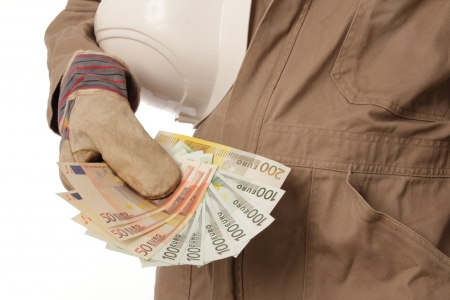 Construction worker with helmet and money in his hand