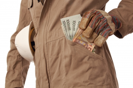 Constructioin worker with helmet and money in his pocket photo
