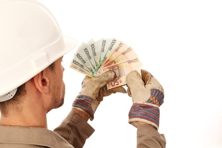 Construction worker counting money _ from behind Stock Photo - 17166113
