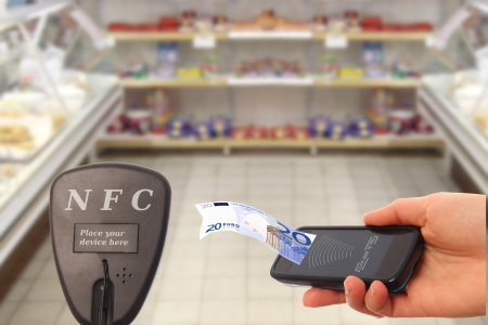 transponder: NFC smartphone paying in a supermarket