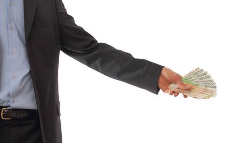 Businessman handing out a lot of money