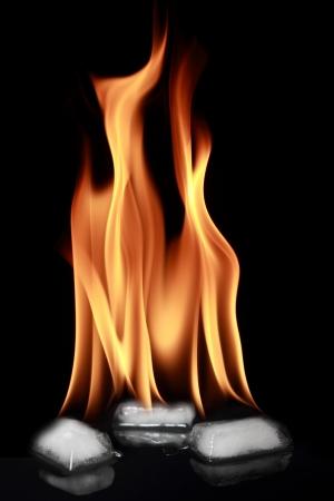 photomontage: Burning ice cubes isolated on black Background Stock Photo
