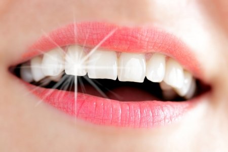 prosthesis: Teeth of a young woman with Light reflex
