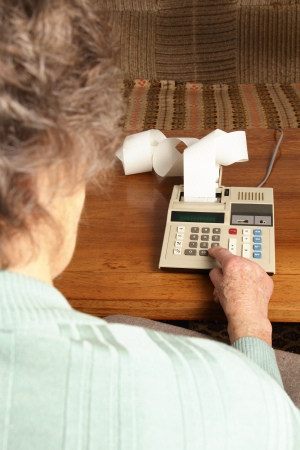 pension cuts: Older Person with calculator