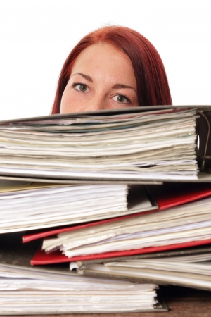 Woman behind a montain of folders in a office photo