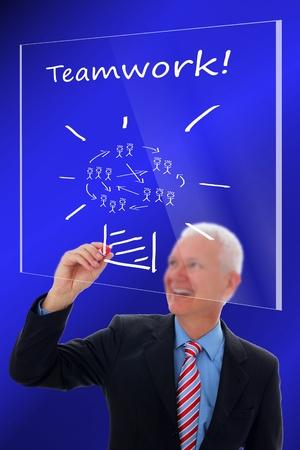 Businessman writing a concept about Teamwork
