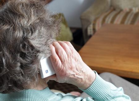 Grandma with smartphone  Standard-Bild