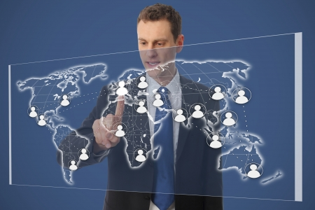 internationally: Businessman with network on a worldmap