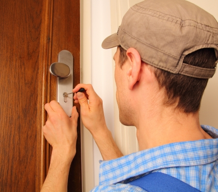 lock out: Locksmith opening a door
