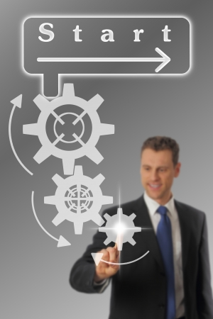 Businessman launching a process by pressung a button