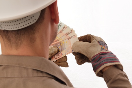 Construction worker counting money Stock Photo - 18843369