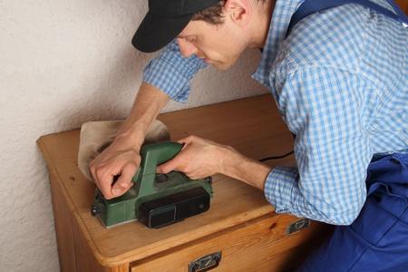 Carpenter renovating old furniture Stock Photo - 19536357