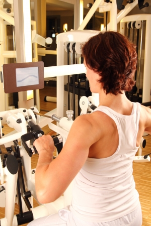 Woman training on in a gym photo