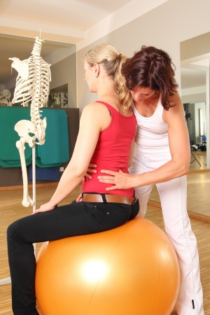 strength therapy: Physiotherapist with patient working on her Lumbar Spine
