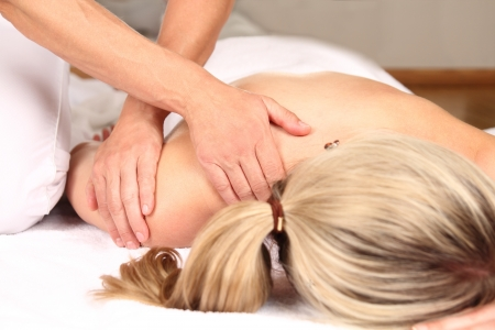 naked woman back: Professional massage Stock Photo