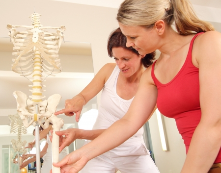 Specialist explaining a hip to a patient Stock Photo