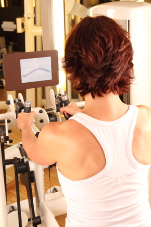 Woman doing workout in gym for  physiotherapy photo