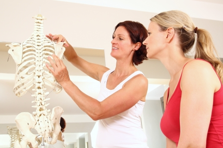 Professional physiotherapist explaining the shoulder Stock Photo