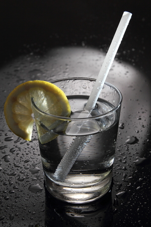 Water or Cocktail on a bar with water drops photo