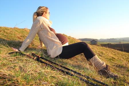 heaving: Pregnant woman heaving a break during a walk