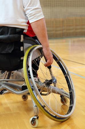 Sportsman in a sport wheelchair photo