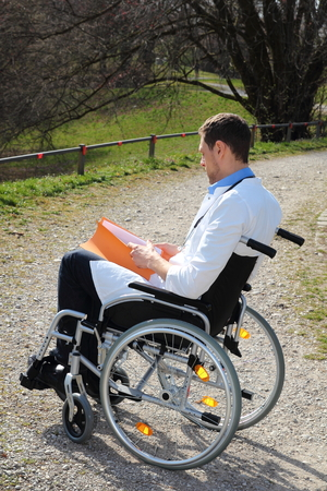 Doctor working in a wheelchair Stock Photo - 27578339