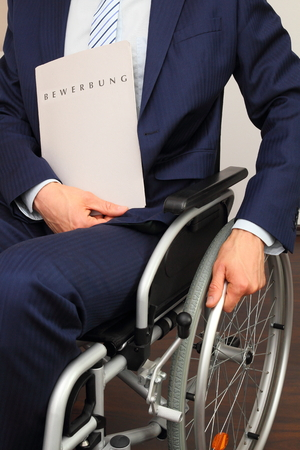 A Job applicant in a wheelchair Stock Photo - 27675271
